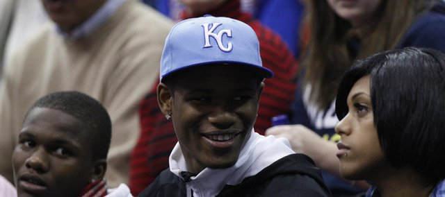 Kansas University recruit Ben McLemore smiles as he sits in the crowd for KU's game against Miami (Ohio) University on Jan. 2, 2011.