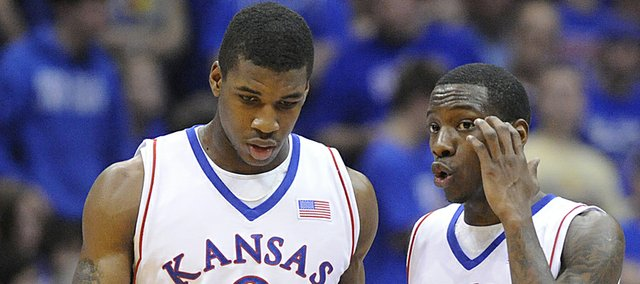KU forward Thomas Robinson (0) and guard Tyshawn Taylor discuss strategy against Tennessee Tech Friday, Nov. 27, 2009 at Allen Fieldhouse.