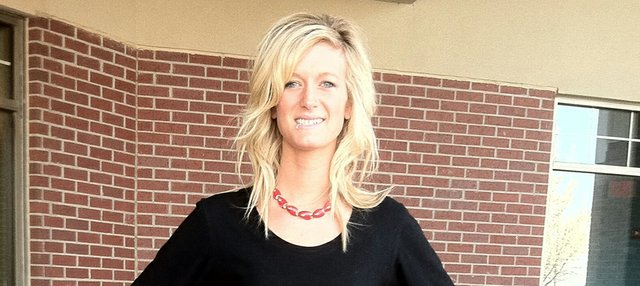 Alisa Lautzenheiser says she is told that she looks like an early Olivia Newton John.