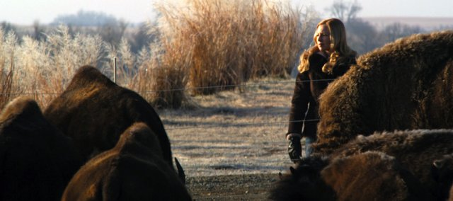 "In ""Au Pair, Kansas,"" Traci Lords plays Helen Hazelton, a recently widowed woman trying raise 50 bison 
