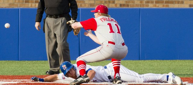 Kansas University's Jason Brunansky slides into home after a wild pitch as Nebraska pitcher Matt Freeman (11) waits for the ball. KU edged the Huskers, 5-4, Friday, April 9, 2011 at Hoglund Ballpark.