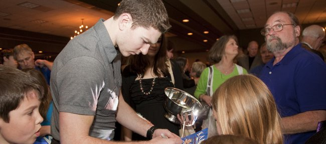 Kansas senior Tyrel Reed signs autographs kids after the KU men's basketball banquet Monday, April 11, 2011 at the Holiday Inn Lawrence. Reed received the Danny Manning Mr. Jayhawk award.