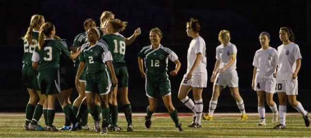 Free State players celebrate a goal against Lawrence High on Tuesday, April 12, 2011 at LHS.
