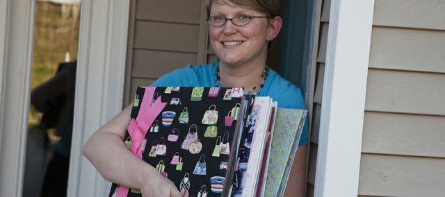Erica Johnson-Wanzer, Lawrence, prefers working with her hands and crafting versus the newer, digital scrapbooking options available.