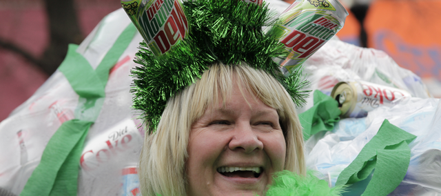 The Can Queen promoted Cans for the Community during the annual Lawrence St. Patrick's Day Parade Thursday, March 17, 2011.