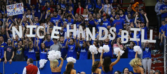 A group of KU fans were quick with their letters and messages during the season. Here they congratulate coach Bill Self for catching an errant pass during the second half of the Jayhawks' 89-66 win against Iowa State Saturday, Feb. 12, 2011, at Allen Fieldhouse.