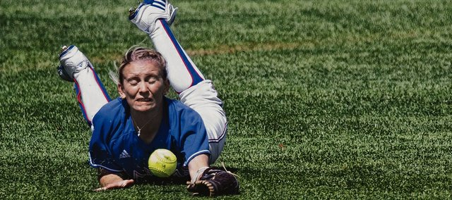 Kansas center fielder Julie Jenkins is unable to make the catch during Kansas softball game against Baylor Saturday, April 16, 2011 at Arrocha Ballpark. The Bears defeated the Jayhawks, 9-3.
