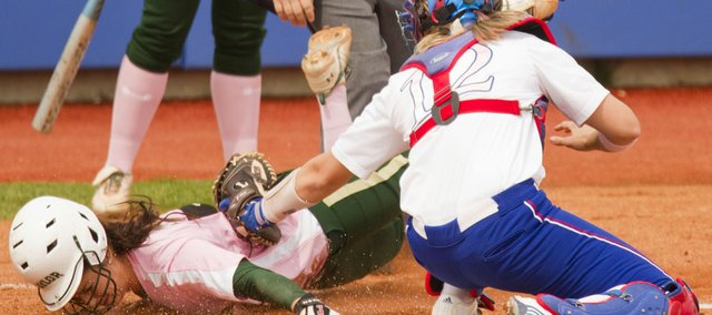 Kansas catcher Brittany Hile tags Baylor's Holly Holl out at the plate Sunday, April 17, 2011 at Arrocha Ballpark.