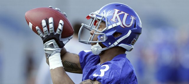 Kansas running back Darrian Miller pulls in a pass during spring workouts at the practice facility on Friday, April 1, 2011.