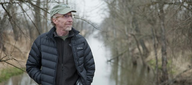 As an Earth Literacy advocate, Doug Hitt identifies himself with a movement seeking to transform human patterns of destruction into mutually enhancing relationships with all life on Earth. Hitt is photographed in the Baker Wetlands March 31, 2011.