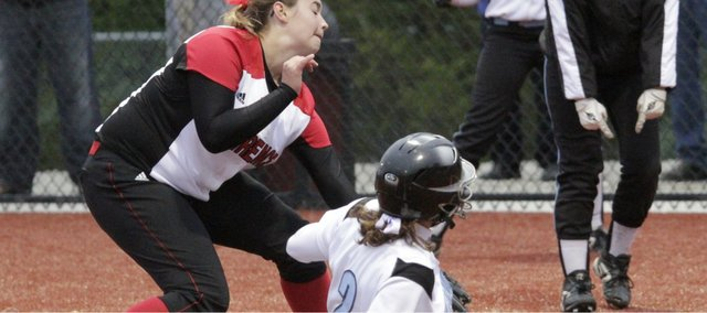 Lawrence High pitcher Lauren Massey winds up against Shawnee Mission East on Tuesday, April 19, 2011 at LHS.