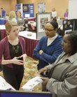 Kelly Evans, executive director of Trinity In-Home Care, left, visits with Lillie Okwuone, center, and Tashawna Hampton, about job opportunities at Trinity. Several employers, including Lawrence Memorial Hospital, Goodyear of Topeka and Motorola Mobility attended the Northeast Kansas Marketplace Job Fair Wednesday, March 16, 2011, at the Lawrence Holiday Inn.