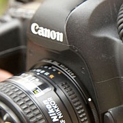 Journal-World photographer Richard Gwin uses a Canon 5D DLSR camera body with a Nikon 50 mm 1.4 lens. Gwin is able to combine lenses and camera bodies from different makers thanks to a Fotodiox Pro Adapter, which is the small, barely noticeable, metal ring between the lens and camera body.