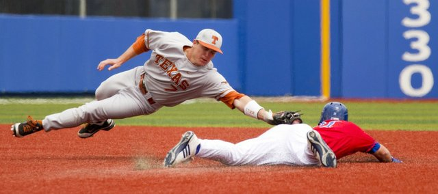 Kansas' Jason Brunansky steals second base, beating the tag by Texas infielder Jordan Etier on Saturday, April 23, 2011 at Hoglund Ballpark.