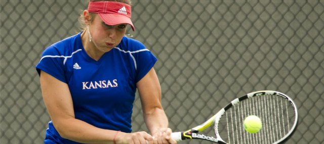 Kansas tennis player Ekaterina Morozova returns a shot during the number-one doubles match against Kansas State on Saturday, April 23, 2011 at the Jayhawk Tennis Facility.