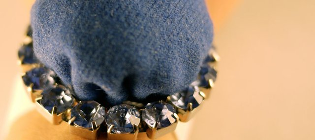 If you're not interested in a $1,500 replica of Kate Middleton's engagement ring to Prince William, you might make your own wearable pincushion inspired by the royal sapphire bling.