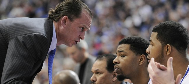 Kansas assistant coach Joe Dooley looks to pump up Morris twins, Marcus, center, and Markieff during the second half Sunday March 22, 2009 at the Metrodome in Minneapolis.