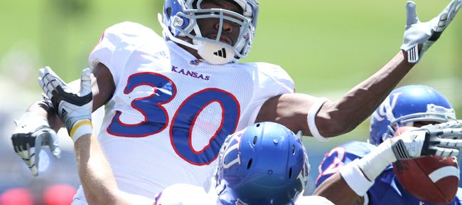 Cornerback Anthony Davis watches as receiver Christian Matthews comes away with a pass for a touchdown during the Kansas Spring Game on Saturday, April 30, 2011 at Kivisto Field.