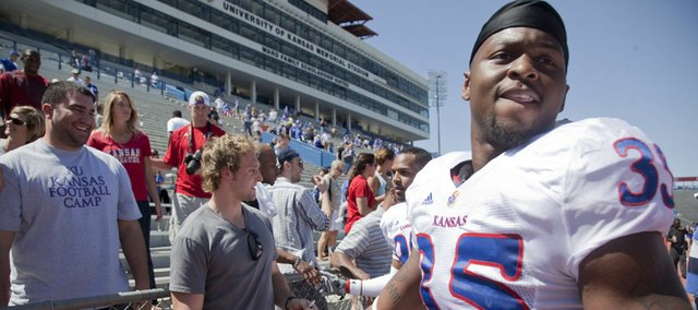 Kansas defensive end Toben Opurum (35) leaves the field after greeting former teammate Kerry Meier following the Kansas Spring Game Saturday, April 30, 2011 at Memorial Stadium.