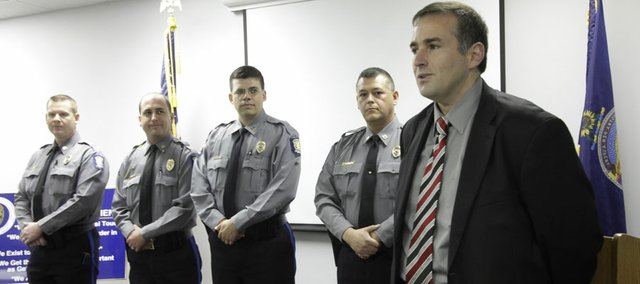 From left,  Sgt. Robert Murry, Sgt. Trent McKinley, Capt. Bill Cory and Capt. Jim Martin were promoted by Lawrence Police Chief Tarik Khatib on Monday, May 2, 2011 at the Lawrence Police Investigations and Training Center, 4820 Bob Billings Parkway.