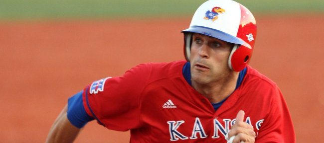 Kansas runner Jake Marasco looks to round third after an RBI single by teammate Brandon Macias during the sixth inning against Wichita State on Tuesday, May 3, 2011 at Hoglund Ballpark. The Jayhawks defeated the Shockers 7-4.