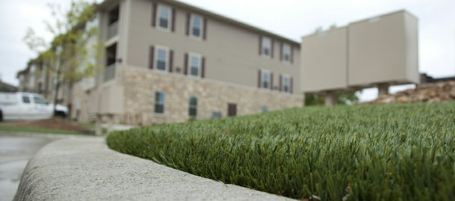 The artificial turf is made of a plastic-like material that allows water to drain into the ground. In addition to the Tuckaway at Frontier Apartments, the turf is also in use at The Oread hotel.
