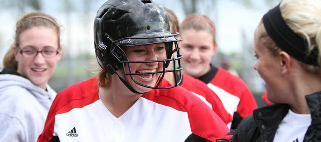Lawrence High senior Lauren Massey laughs with her teammates after hitting a home run during the second inning against Shawnee Mission North on Thursday, May 5, 2011 at Free State.