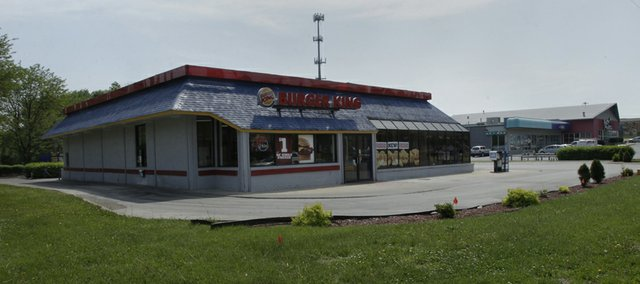 Natural Grocers is planning to build a 14,000-square-foot store at 23rd Street and Naismith Drive, where this Burger King is located.