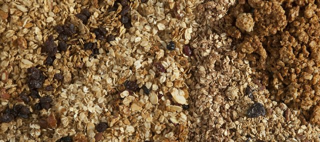 From left to right are the The Merc's old-fashioned granola, Great Harvest Bread Co.'s raisin granola, Jefferson Hill Vineyard's heart-healthy granola, Jefferson Hill's original granola, Hippie Chow's chocolate granola, Bread of Life's cherry-nut granola and Hometown Granola Shop's peanut butter crunch granola.