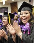 Haskell graduates Tara Hammer, left, and Tennille Begay of Tuba City, Ariz., were just two of the joyful students who graduated from Haskell Indian Nations University Friday, May 13, 2011.