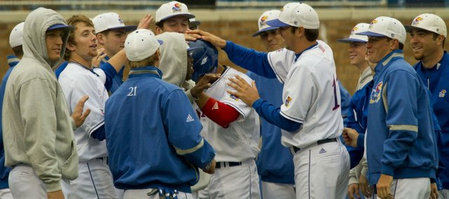 Kansas second baseman Ka'iana Eldredge is congratulated by teammates after hitting a solo home run in the bottom of the second inning Friday, May 13, 2011 at Hoglund Ballpark.