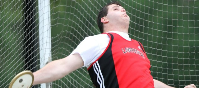 Lawrence High junior Blake Hocking competes in the discus in the Sunflower League Invitational. Hocking took second in the event on Friday, May 13, 2011 at Shawnee Mission North High School. He placed first in the shot put.