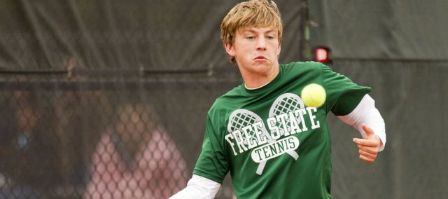 Free State's Patrick Carttar returns a shot during his doubles match in the 6A state championship tournament Saturday, May 14, 2011 at the Kossover Tennis Complex in Topeka.