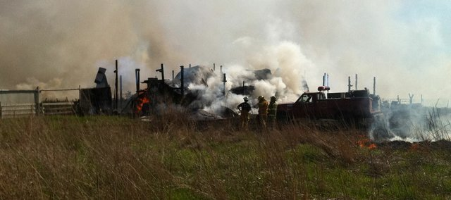 Firefighters responded to a grass fire that had expanded into a barn in the 1800 block of County Road 1023 Monday, May 16, 2011.