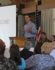 Gov. Sam Brownback speaks Tuesday during the Flint Hills Visioning Summit held at Camp Wood YMCA near Elmdale in the heart of the Flint Hills. Brownback encouraged the development of more tourism opportunities in the area.