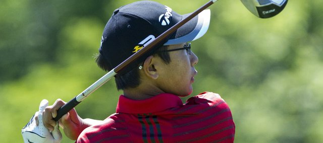 Lawrence High's Jesse Ohtake watches his drive on the 16th tee. The freshman qualified for state as an individual with an 86 at the regional golf tournament at St. Andrews Golf Club in Overland Park on Monday, May 16, 2011.