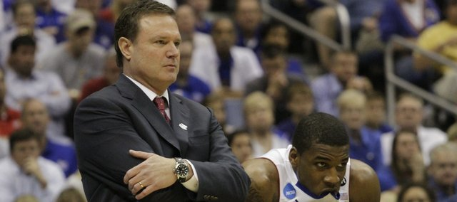 Kansas head coach Bill Self, left, and Thomas Robinson (0) watch from the bench as the VCU Rams jump to an early lead on Sunday, March 27, 2011 at the Alamodome in San Antonio.