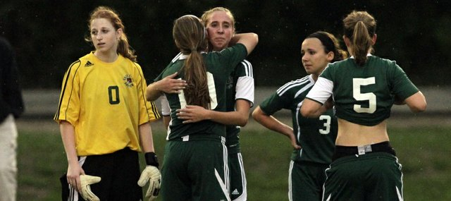 Free State soccer players react after their 2-1 loss to Manhattan in their Class 6A regional championship game Thursday in Manhattan.