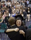 The emotions of the moment affect graduating senior Sarah Henry as she hugs faculty member Matthew Patterson during Bishop Seabury Academy's commencement ceremony Friday, May 20, 2011.