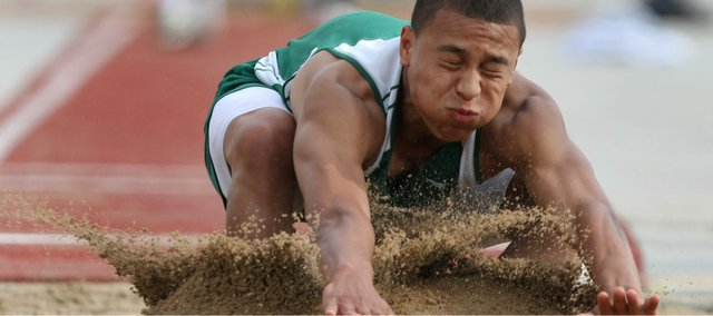 Free State sophomore Demarco Bobo crashes into the sandpit during the boys long jump at the 6A regional track and field championships Friday, May 20, 2011 at FSHS. Bobo qualified for state with Friday's effort.
