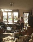 Jean Logan reacts as she sees the damage to her home in Joplin, Mo., Monday, May 23, 2011, after it was damaged by a tornado that destroyed nearly 30 percent of the town on Sunday afternoon. Logan and her granddaughter rode out the storm in the laundry room. The twister cut a six-mile path through the city.