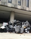 Chairs and fold-out desktops await removal from the steps of Wescoe Hall at Kansas University. The items had been removed Monday morning from two auditoriums, which are being renovated.