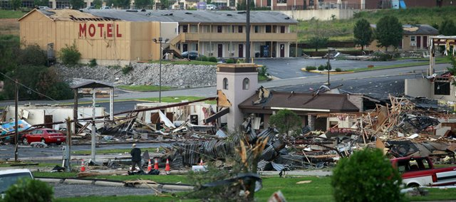 Businesses near St. John's Regional Medical Center show damage on Monday from the tornado that hit Joplin, Mo., on Sunday, killing at least 116 people. Former Kansas University guard Jeff Boschee, an assistant coach at Missouri Southern State University in Joplin, was not caught in the path of the tornado and sought shelter at his wife's parents' house in nearby Columbus (Kan.).
