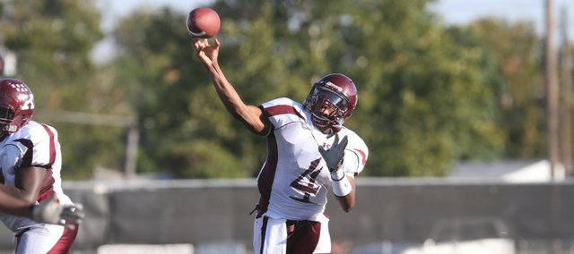 Killeen (Texas) High quarterback Michael Cummings throws against Killeen Shoemaker on Sept. 4, 2010, at Leo Buckley Stadium.