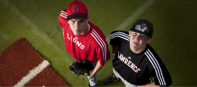 Lawrence High starting pitchers Alex Laughlin, left, and Garrett Cleavinger are geared up for the state tournament Friday, May 27, 2011 against Shawnee Mission West at Kansas University's Hoglund Ballpark.