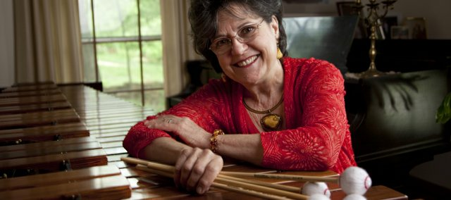 Lawrence resident and classical marimbist Linda Maxey is pictured May 24 in her home. Maxey has been playing the percussion instrument since the age of 6 and regularly travels for extended stays in Lithuania to teach.