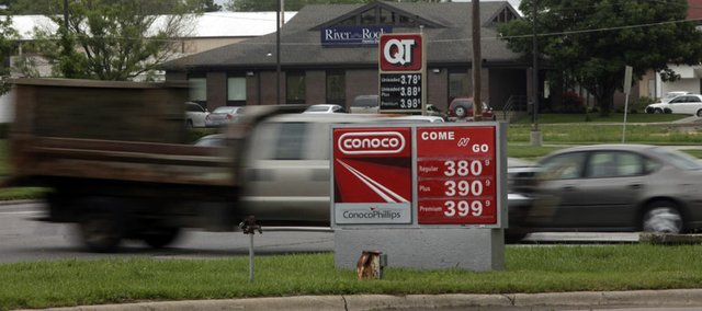 Gas prices in Lawrence are currently above the national average and well above neighboring cities' gas prices. There is no explanation for why the prices are currently so much higher.