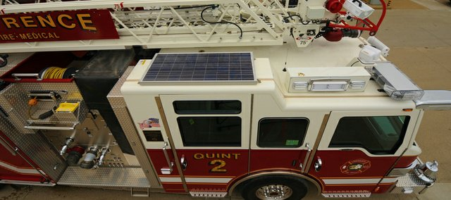 This Lawrence fire engine has a solar panel on its roof, which is used to power its lights and radio equipment. The fire engine is one of the city's 573 vehicles. The city purchases fuel in bulk, about 7,000 gallons at a time.