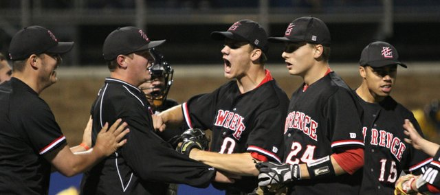 Lawrence High players celebrate following the Lions' 2-1 win over Shawnee Mission West during the first round of the 6A state championships at Hoglund Ballpark. At center is starting pitcher Alex Laughlin, who got the win, and Aaron Gile (24), who drove in the winning run in the seventh.