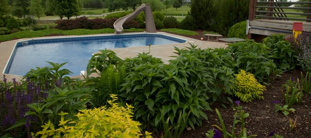 One of the stops on the Master Garden Tour will be at the home of Debbie Hutton. Many plant varieties that complement a gazebo area.